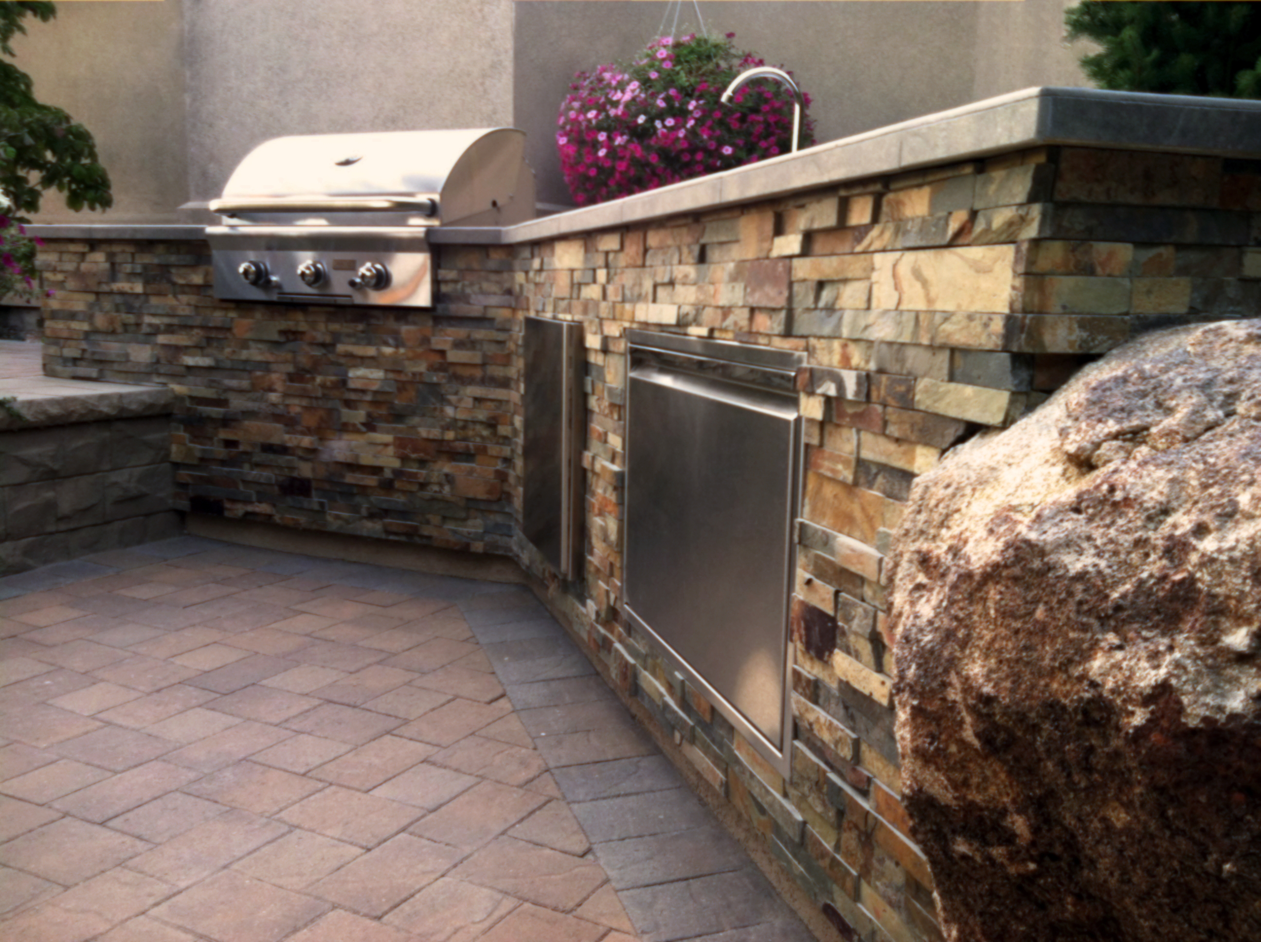 Custom Outdoor Kitchen with Boulder - 1 | The Garden Artist Boise, ID