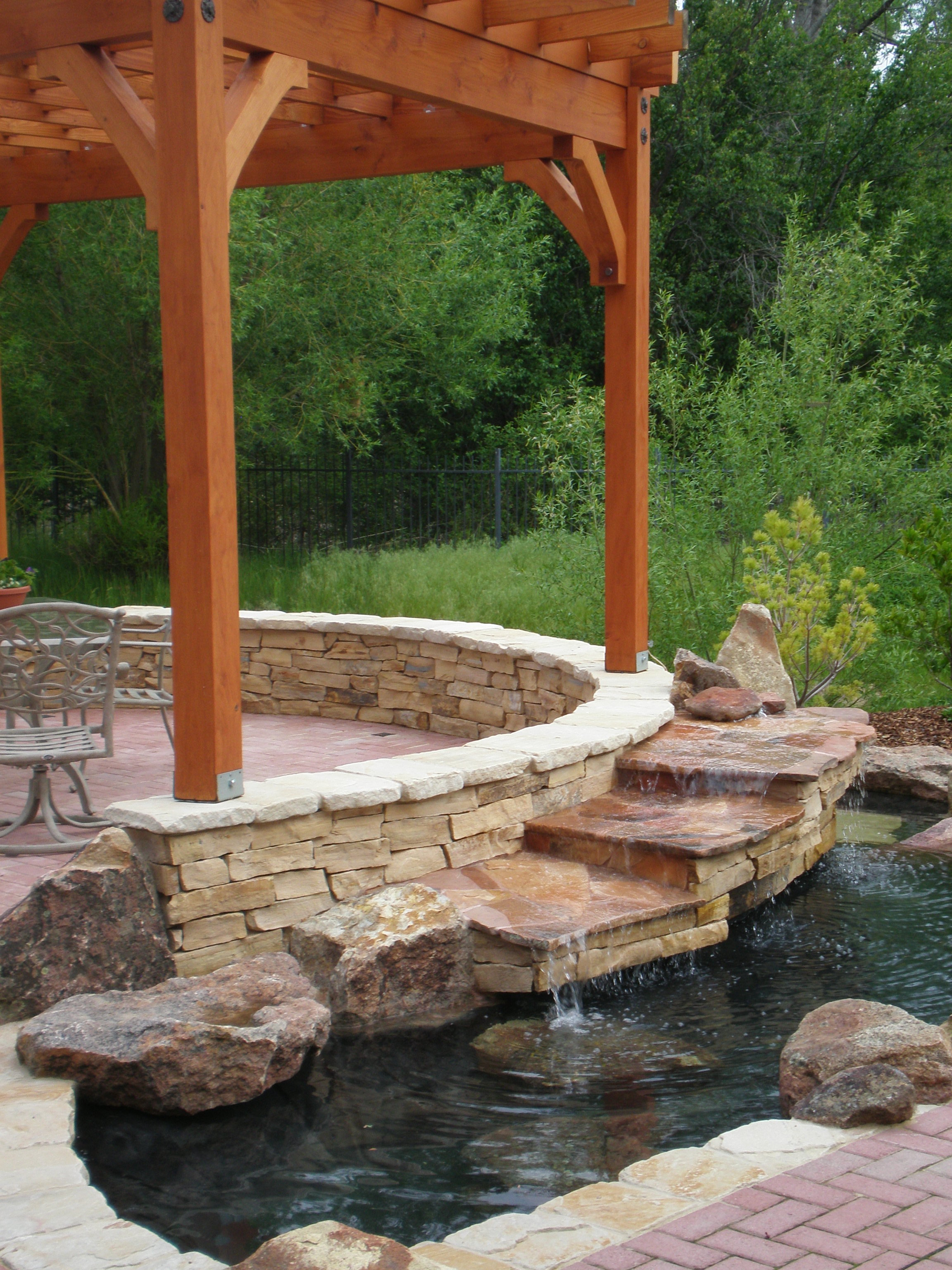 Pergola with Stepped Waterfall | The Garden Artist Boise, ID